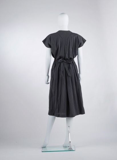 ISSEY MIYAKE - Spring-summer 1975  Black cotton dress with removable pleated apron...