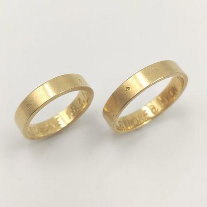 Deux alliances en or jaune (750 millièmes),...