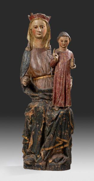 Groupe en bois sculpté représentant une Vierge...