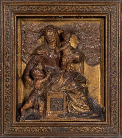 Rare panneau en bois sculpté en haut-relief...