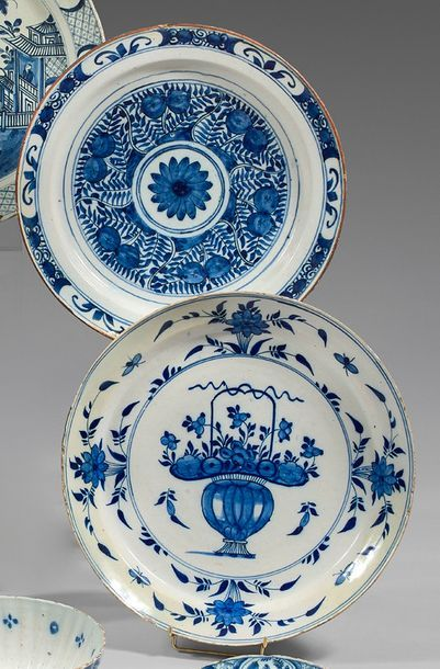 DELFT Two dishes and a plate with a contoured border in earthenware with blue monochrome...