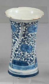 DELFT Small earthenware vase and bowl with blue monochrome decoration. The vase with...