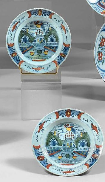 DELFT Pair of plates and pair of earthenware cups with polychrome decoration on a...
