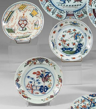 DELFT Three earthenware plates with polychrome decoration, one with pierced rocks...