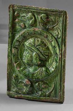 NUREMBERG Rectangular stove tile made of green glazed earthenware representing a...