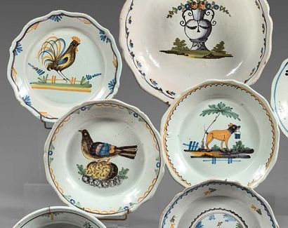 NEVERS et WALLY Four earthenware plates with contoured edges, with different polychrome...