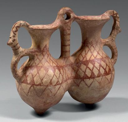 Double rhyton with globular rumen and high concave neck. They are joined together...