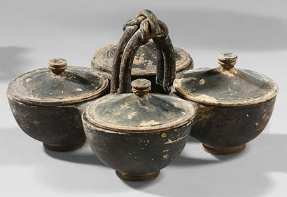 Kernos with quadruple pyxides and Heracles knot handle. Grey terracotta with black...