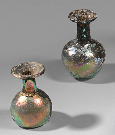 Batch of two vials with globular rumen and high neck, and one bottle with faceted...
