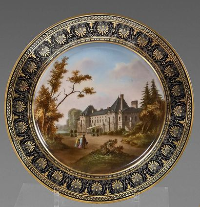 SÈVRES Plate in hard porcelain, the blue wing decorated with palmettes and gold friezes;...
