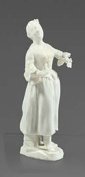 TOURNAI Figurine in soft white enamelled paste, representing a young woman standing...