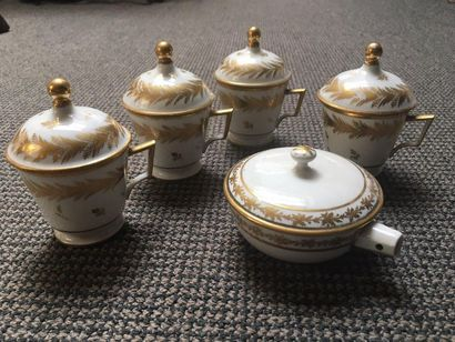 PARIS Suite of four covered porcelain juice jars in the shape of a truncated cone...