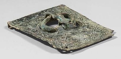 Buckle plate with ring and barb placed inside a decoration of volutes and crosses....