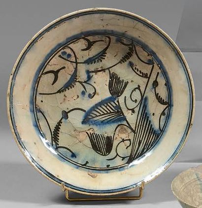 IRAN Circular ceramic bowl with a siliceous cover with blue and brown painted decoration...