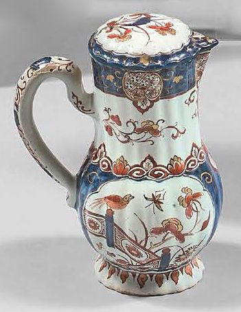 DELFT Covered earthenware gadrooned jug with imari decoration in blue, red and gold...