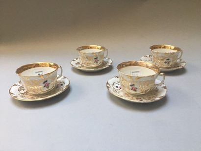 PARIS Four porcelain cups and their saucers decorated with roses polychromatically...