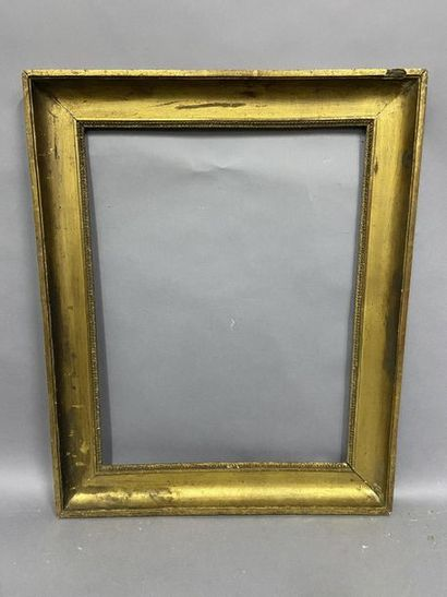 Moulded and gilded hollow groove wooden frame...
