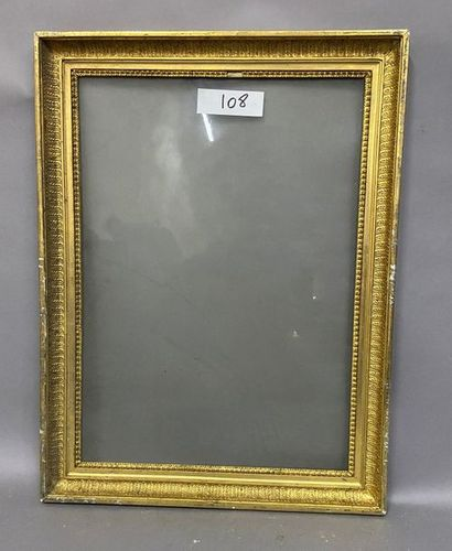Wooden frame and gilded paste with palmette...