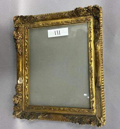 Sculpted and gilded oak frame with floral...