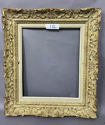 Carved and patinated wood frame called ''Montparnasse''....