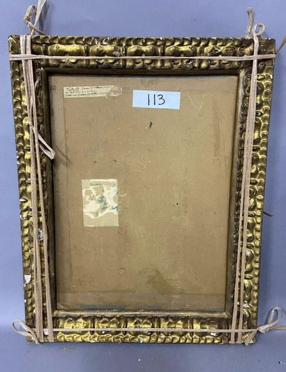 Carved and gilded wooden frame with a leafy...