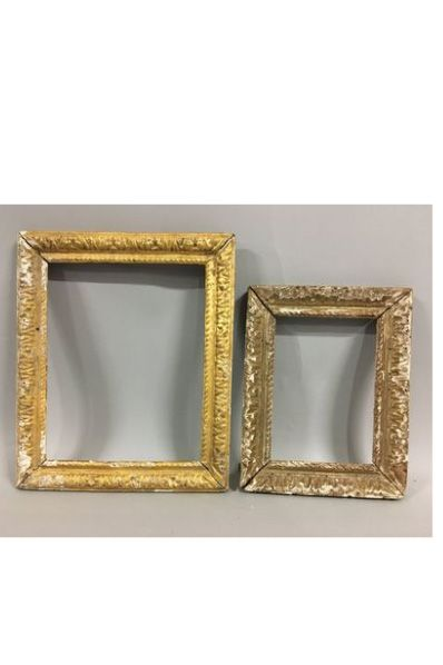 Two carved and formerly gilded limewood frames...