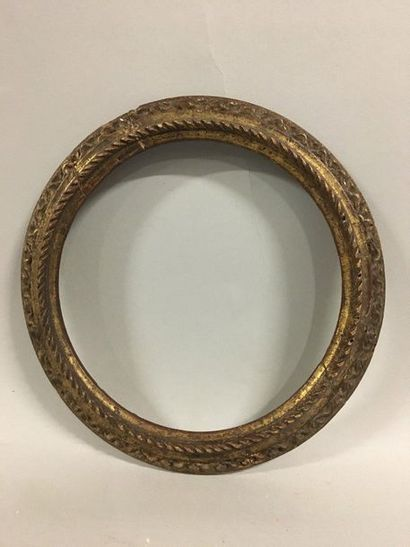 Carved and gilded wooden frame with an upside...