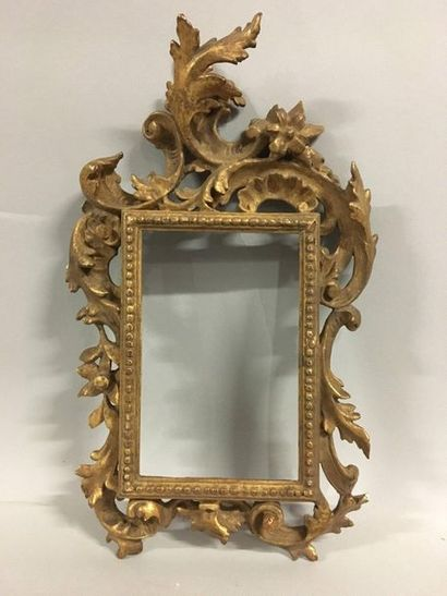 Carved and gilded wood monoxyl frame with...