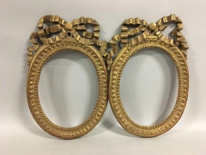 Pair of carved and gilded oval wooden frames...