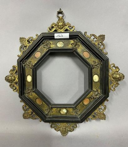 Octagonal moulded and blackened wood frame...