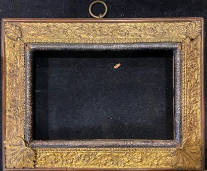 Wooden frame with an upside-down profile...