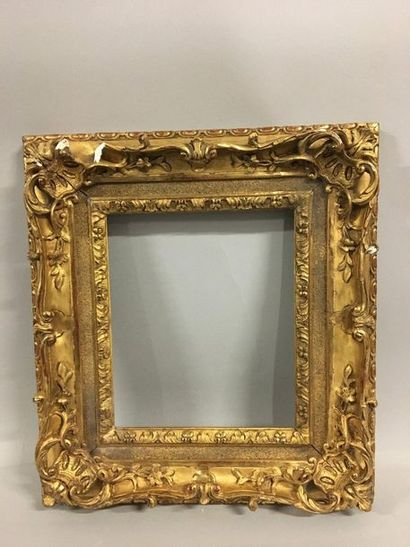 Carved and gilded wood frame with floral...