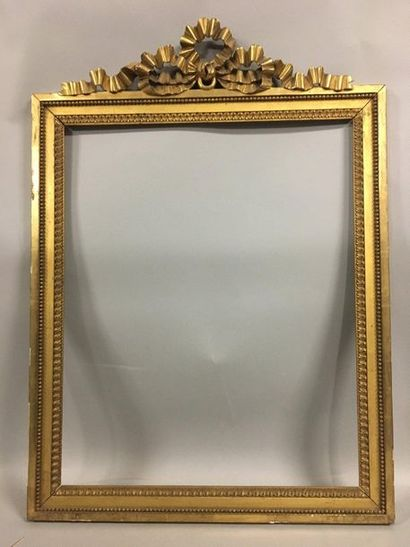Carved and gilded wooden frame with heart...
