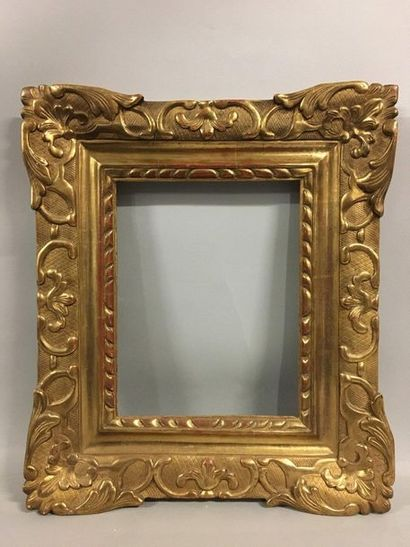 Carved and gilded wooden frame with Bérain...