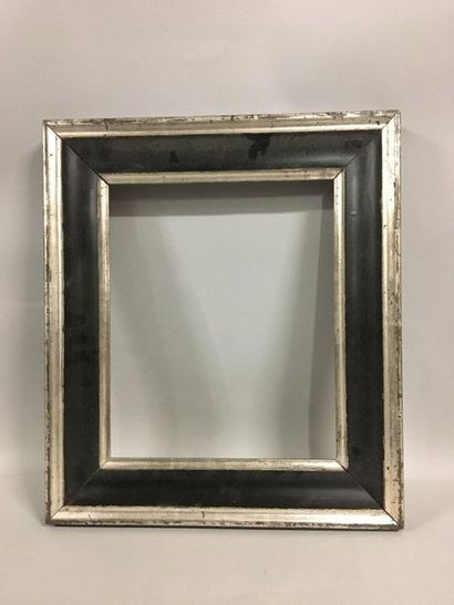 Silver and blackened moulded wooden frame....