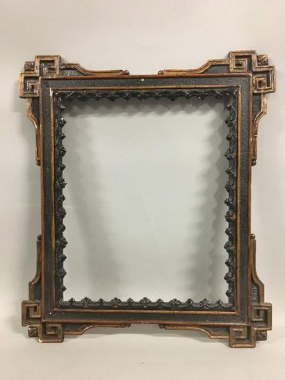 Wooden frame and gilded and blackened stucco...