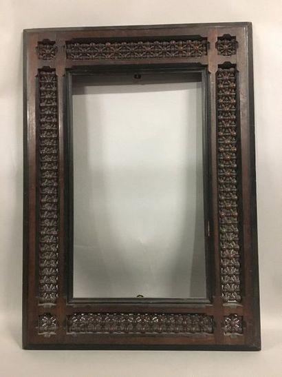 Carved wooden frame with a