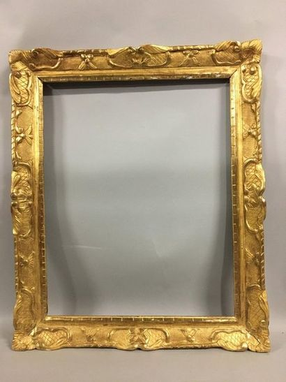 Carved and gilded wood frame with Bérain...