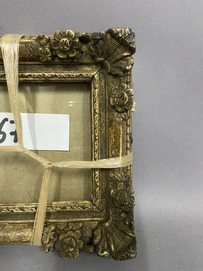 Two small carved and formerly gilded wooden frames, one from the Louis XIV period,...