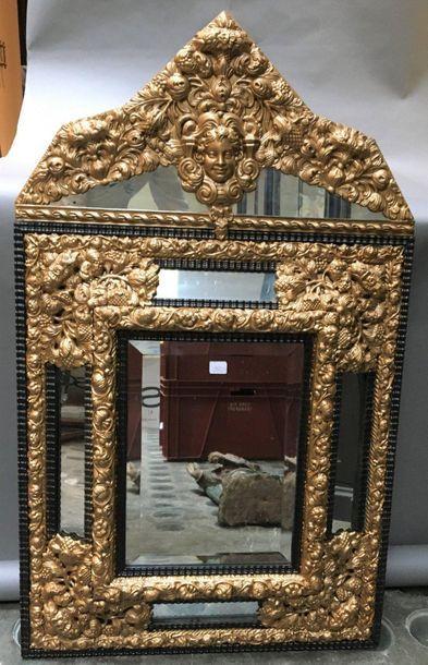 Miroir à parecloses en bois noirci riche...