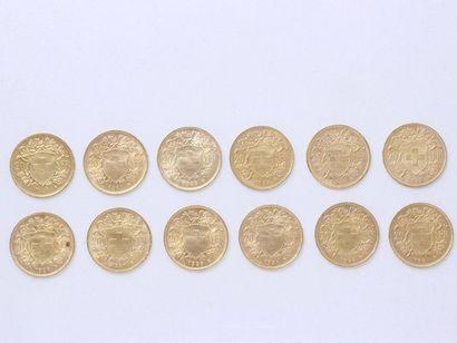 Lot en or 750 millièmes composé de: - 12 pièces de 20 francs suisse or. Poids: 77.30...