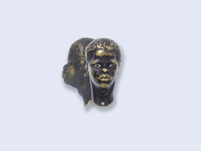 Petit buste de jeune nubien en bronze patiné,...