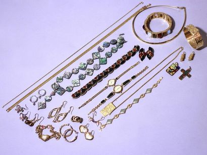 Lot in gold and silver plated metal, made up of various costume jewels, some signed...