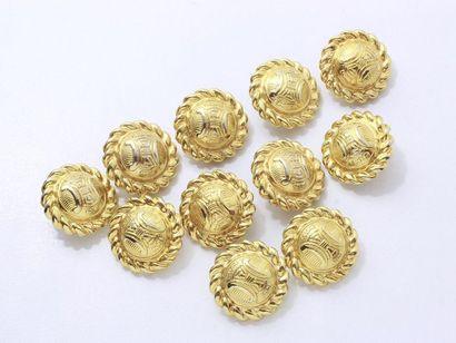 CELINE. Lot en métal doré, composé de 11...