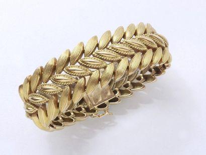 Bracelet articulé en or 750 millièmes, composé...