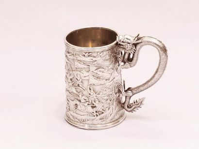 Silver mug. China, 20th century. On a flat background, decorated with battle scenes,...