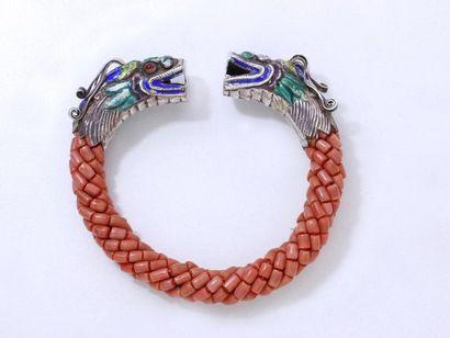 Bracelet jonc ouvert composé d'une tresse...