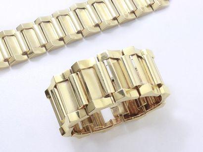 Important bracelet tank en or 750 millièmes...
