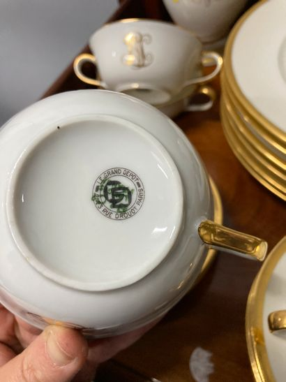 Porcelain tea/coffee set with cups and saucers. A large set of plates, with white...