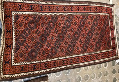 Batch of two Persian carpets red background...